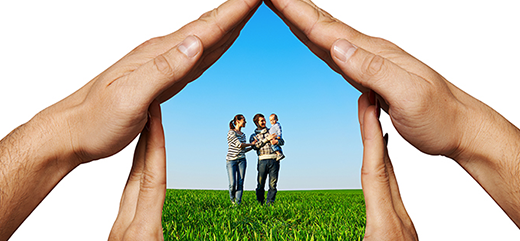 House-shaped hands with family inside it.