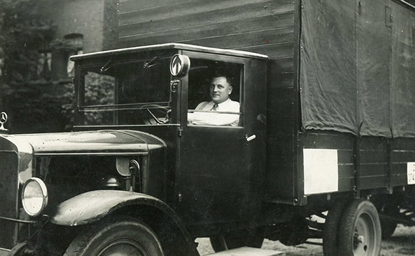 Vintage photo of truck and truck-driver.